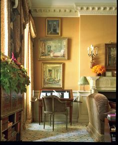 What's not to love?  Everything is perfect....the crown moulding, apricot walls, artwork, antiques.