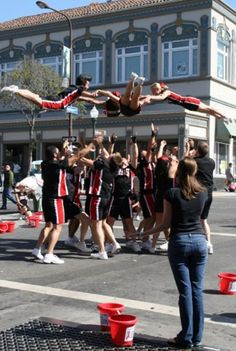 Cheer SF team doing a helicopter stunt at the How Berkeley Can You Be? festival, 2009 - Photo by Talia Kennedy