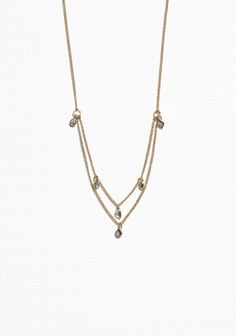 Opt for a layered jewellery look with this delicately made necklace, featuring petite rhinestone pendants.