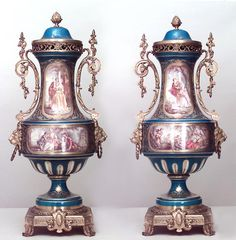 Pair Of French Victorian Turquoise Sevres Porcelain Urns/Vases With Cover And Bronze Trim Handles With Lion Head Sides