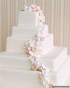white cake w/ pastel roses