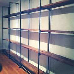 Custom-Sized Industrial Pipe And Reclaimed Wood Shelving custom made by J Reclaimed Wood Custom Furniture Industrial Pipe Shelves, Rustic Industrial, Wood Shelves, Pipe Shelving, Industrial Design, Pipe Bookshelf, Custom Shelving, Rustic Wood, Plumbing Pipe Furniture