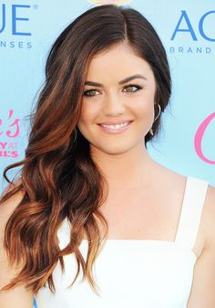 Lucy Hale looks fresh-faced and simply glowing with glossy lips and side-swept hair