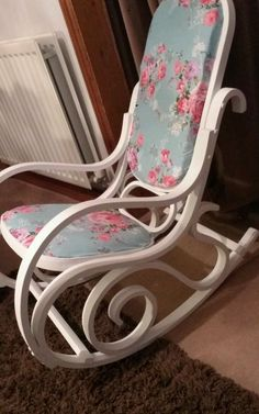 Bentwood rocking chair, paint in brilliant white chalk paint and waxed for protection.. White glitter studs finishes off the beautiful cath kidston fabric.