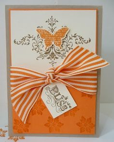 I do not normally like the color orange for cards but this is beautiful and elegant. Love it!