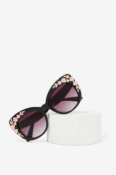 96bc0000989 Hide early mornings and late nights in these black laquered cat-eye shades  with gold and pink floral detailing at sides