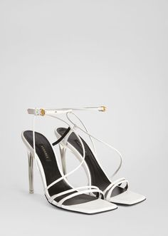 Antheia Sandals from Versace Women's Collection. Understated, yet elegant, these nappa leather sandals feature a clear, plexi heel. Valentino Heels, Ysl Heels, Versace Shoes, Dior Shoes, Strappy Heels, Shoes Heels, Versace Clothing, High Heels, White Sandals