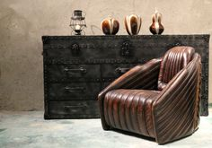 The Sopwith Camel Aviator Chair...swept back lines reminiscent of the biplane era of WWI. Vintage leather combines with wooden detailing to create our stunning signature aviation chair...