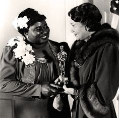Hattie McDaniel receiving the Oscar for Best Supporting Actress for her performance as Mammy in Gone With The Wind.