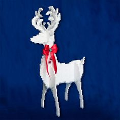 """<p>Designed By Lennis Rodriguez</p> <p>Our handsome white reindeer stands about 15"""" tall and is easy to make with Perler beads and slot-to-slot assembly. Add a bright red bow with small jingle bells around his neck for a festive look!</p>"""