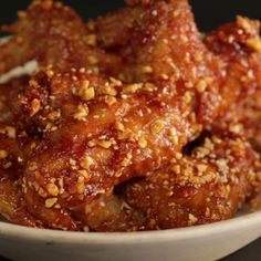 How to make Spicy Crispy Korean Fried Chicken; Dakgangjeong.. Ingredients: Ingredients:, Frying oil, ¼ cup cornstarch, For the chicken, 14 single chicken wings, 1 tsp salt, ¼ tsp black pepper, 1 tsp grated ginger, ¼ tsp curry powder, 1 Tbsp soju, For the sauce, 5 cloves garlic, chopped, 1 Tbsp soy sauce, 2 Tbsp mirin, 1 Tbsp gochujang, 1 Tbsp ketchup, ¼ cup corn syrup, To serve, 2 Tbsp finely chopped roasted peanuts, 1 tsp sesame seeds