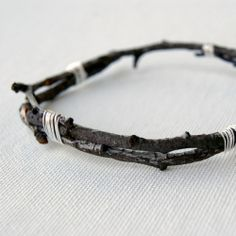 A nearly-free and simple craft using twigs from your yard and a bit of craft wire.  Wear a bit of nature!
