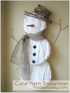 Here you go, Mames... Yarn and Burlap Snowman~ Make into a decoration or ornament to hang off a gift or the tree.