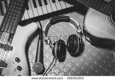 music instruments band the microphone,headphones,bass,acoustic guitar,electronic piano on floor background. #468351953