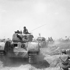 British advancing in Italy - Churchills of 56 Infantry Division near Argenta, Italy, April 1945.