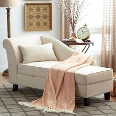 Chic bedroom reading corner is filled with a white roll arm chaise ...