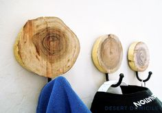 DIY Gold Leaf Wood Slice Coat Hangers –Don't need any coat hangers? Make one anyway but hang it in your bathroom to hold your hand towel instead! #diy #goldleaf #coathanger