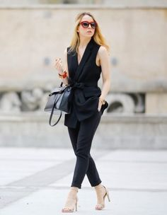 black vest with pants and red sunglasses