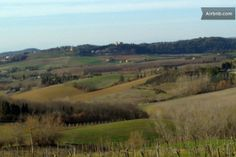View on the countryside near Lecchi with Strozzavolpe Castle, in early spring.