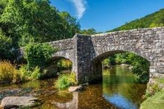 Information on the popular Dartmoor beauty spot of Fingle Bridge, near Castle Drogo, with a history of the bridge, nearby walks, and visiting information. Castle Drogo, Homes England, State Of Decay, Michael Church, Dartmoor National Park, Wood River, Over The Bridge, Exeter, Countryside