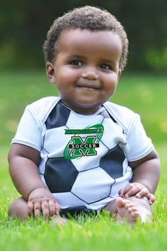This baby is so lovable/squeezable in his MVP soccer ball bodysuit..Patented Product and graphic created by College Kids, llp