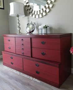 Chic and Shabby Furniture By Rebecca. Mid-century mahogany dresser redone in a red with stain and glaze. Distressed slightly for a little bit of a shabby or farmhouse, modern feel.