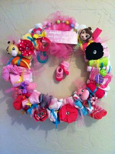 Baby Shower Wreath. Complete with diapers, hair bows, onesies, wash cloths, rattles, pacifiers, and teething rings.