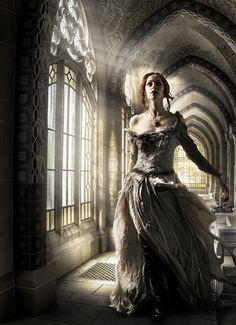 """""""The Hallway"""" by Frank Bramkamp This is my first major composite photo. I took the photo of the hallway a few days ago. It belongs to an abbey of our local cemetery, Aachen, Germany that I discovered recently. I think the dress of the model perfectly fits ot the historic scene."""