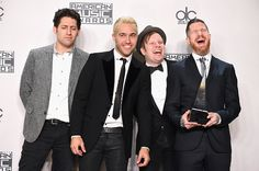 Pete, Patrick and Andy are all laughing and smiling, and then there's Joe who's like 1000% done with all of them
