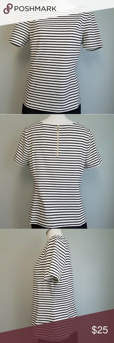 """Banana Republic Striped Ponte Exposed Zipper Top Stretch fit ponte top with short sleeves. Exposed Gold zipper down back. Adorable top that pairs well with jeans or slacks! In great condition! Size 12. Bust 19 1/4"""". Hem at hips 19.5"""". Sleeves 8 3/4"""". 21 3/4"""" long in back. 16"""" shoulder to shoulder. Banana Republic Tops"""