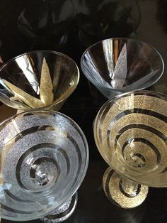 Four martini glasses artfully sprayed with Rust-Oleum Specialty Glitter Spray Paint