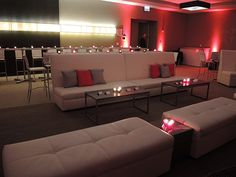 Sophistication Sofa | Novel End Table | Aria Cocktail Table - Charcoal | Whisper Bench | Criss Cross Bar Stool - White #afreventfurnishings #afrfurniturerental #furniture