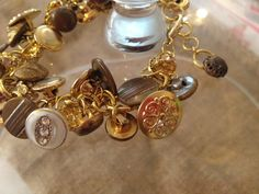 Antique Button Bracelet in Gold Tones with by chayrlsfancyjunk, $65.00  http://www.etsy.com/shop/chayrlsfancyjunk