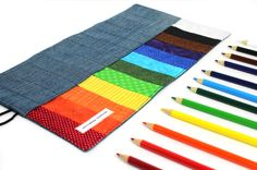 "Large Pencil Rolls 40.00  ""Every human is an artist. The dream of your life is to make beautiful art."" ~ Miguel Angel Ruiz  Our pencil roll is designed to help you keep your creative tools organized and close at hand, beautifully.   Beauty.  Order. Functionality. Sustainability. What better to inspire the artist in all of us?  Set of 12 colored pencils included."