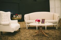vintage inspired lounge area decorate with oversized cream furniture, cute signage and florals: Bridal Bliss Wedding
