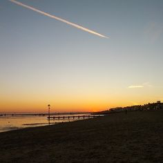 Plane in the sky as the sun sets on Southend-on-Sea.   http://www.lovesouthend.co.uk/landmarks-attractions/seaside