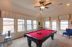 Game Room: Create a statement with this fun billiard room. The valences repeat the red felting on the pool table. A row of windows along the wall lets in plenty of natural light. Simple window treatments don't detract from your view.