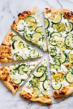 summer pizza recipe made with fresh zucchini, garlic, lemon, goat cheese, mozzarella and chives.