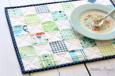 Combine some printed and plain fabric scraps in this easy to sew scrappy patchwork placemat.