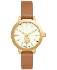 A serene, open design is intriguing to the eye on this watch from Tory Burch's Collins collection. | Light brown two-piece leather strap | Round gold-tone case, 38mm | Cream glossy dial with gold-tone