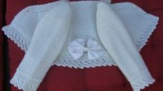 """Beautiful baby jacket with lace trimming and grosgrain ribbon on the back. For this type of basic jacket (shortish, V-neck), you can follow the detailed instructions in the blog """"Liando Labores de Punto"""" [http://liandolaborespunto.blogspot.com/2013/11/chaquetita-basica-bebe.html] by Emilia Alvarez Perdiguero. The lace edging is very easy to add."""