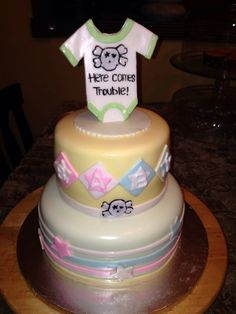 Here comes trouble baby shower cake
