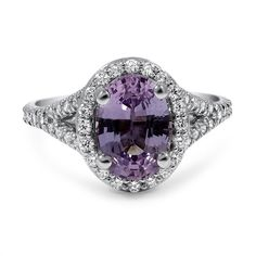 This exquisite custom rendition of our Harmony Diamond Ring showcases a majestic lavender colored sapphire set above a filigree designed gallery. Scalloped pavé diamond accents encompass the shank and sapphire in an array of sparkle.