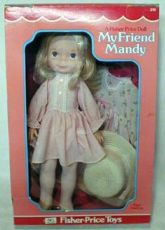 """@Kim Jester--In 1977 Fisher-Price introduced the very first """"My Friend"""" doll...Mandy. Unlike most dolls, Mandy is not a baby, she is a little girl, the perfect age to be a best friend. She has a white cloth hard stuffed body so she can stand, sit, or lay down for bedtime. Her body is covered with little pink rosebuds. She has a vinyl head, arms and legs, long soft blonde hair, blue eyes and a sweet smile."""