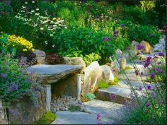 Westover Landscape Design, found on DIY network.  Cleaver way to incorporate a bench into a stone retaining wall.