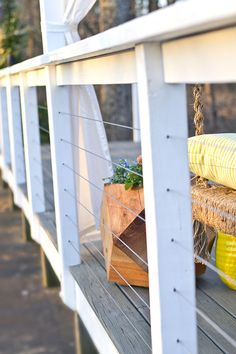 DIY cable railing on a restored backyard deck