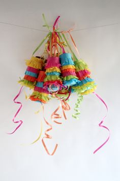 These little pinatas are made from tp rolls and filled with little trinkets. A ribbon pull breaks them open. How cute is this! Great party favor.