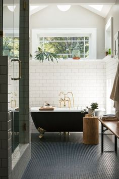 What's a bathroom without a traditional #freestanding #bath Centre stage, our Winchester freestanding bath is complemented by gold brassware, greenery and industrial style tiles