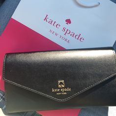 Kate Spade Envelope Wallet Brand new with tag and care info. Never used. Gorgeous smooth leather with pink inside. kate spade Bags Wallets