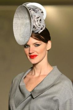 Models Wear Hats By Philip Treacy British Hat Designer During The Fashion Show At